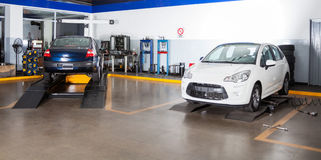 Cars At Auto Repair Shop. Cars for maintenance at auto repair shop Royalty Free Stock Image