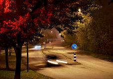 Cars in autumn evening Royalty Free Stock Photography