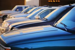 Cars background. Row of cars in parking lot. Abstract background. Shallow DOF Stock Photo