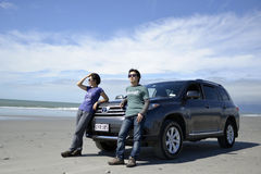Cars, beach,and people Royalty Free Stock Images