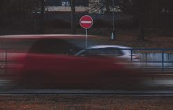 Cars in blur motion. No entry sign. Royalty Free Stock Photo
