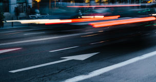 Cars in a Blurred City Scene Royalty Free Stock Image