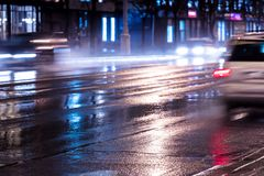 Cars in blurred motion at night with switched on headlights. Cars in motion at night with switched on headlights. blurred view of city road Royalty Free Stock Photography