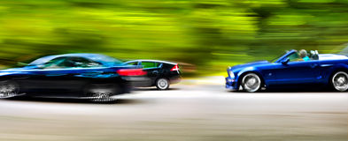 Cars in blurred motion on road. Abstract background. Stock Photo
