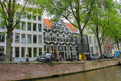 Cars and boats near the waterfront canal in Amsterdam Royalty Free Stock Images