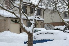 Cars buried in heavy snow in a residential area in a Canadian city. Vehicles covered in heavy snow in a residential area in a Canadian city Stock Photos