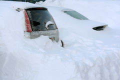 Cars buried in snow. Two cars buried in high snow Royalty Free Stock Photo