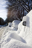 Cars buried in snow. With only the side view mirror visible. Location: Tøyen, Oslo, Norway Stock Image