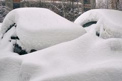 Cars buried in snow on moscow street after a great snow storm. In February 2018 Royalty Free Stock Photos