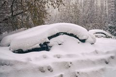 Cars buried in snow on moscow street after a great snow storm. In February 2018 Royalty Free Stock Image