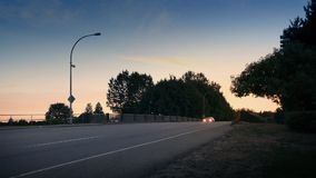 Cars And Bus On Highway At Sunrise. Many vehicles passing on road in the morning stock video