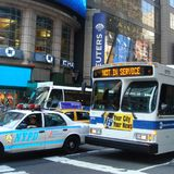 Cars and bus in Times Square royalty free stock photography