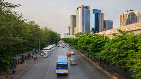 Cars, buses, taxis and people crowd on street at Chatuchak park royalty free stock photo