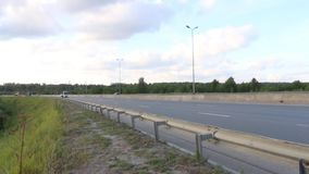 Cars, buses and trucks move on modern highway at summer day. Time lapse stock footage