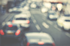 Cars on busy road. Blurred out traffic. Royalty Free Stock Image