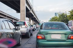 Cars on busy road in the city with traffic jam Stock Images