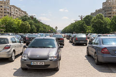 Cars In Car Parking Lot In Front Of Parliament Palace Stock Photos