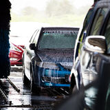Cars in a carwash Stock Images