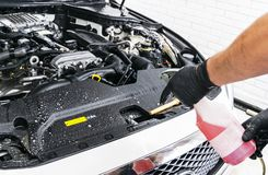 Cars in a carwash. Car wash with foam in car wash station. Carwash. Washing machine at the station. Car washing concept. Car detai. Ling. A man cleaning car stock images