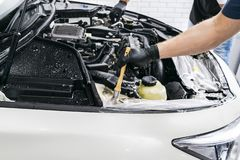 Cars in a carwash. Car wash with foam in car wash station. Carwash. Washing machine at the station. Car washing concept. Car detai. Ling. A man cleaning car stock photo