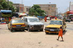 Cars and child in a square in Dakar, Senegal Royalty Free Stock Photos