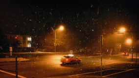Cars In City At Night With Snow Falling stock video footage