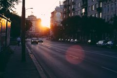 Cars on city street at sunset Stock Photography