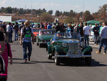 Cars coming through the crowd Royalty Free Stock Image