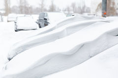 Cars covered with fresh white snow Stock Photography