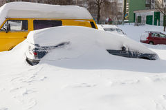 Cars covered in snow Stock Photos