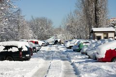 Cars covered by snow on parking Stock Images