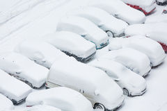 Cars covered in snow on a parking lot. In the residential area during December snowfall Royalty Free Stock Photos