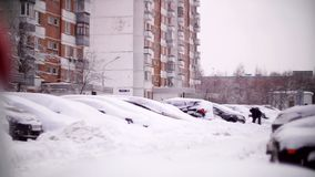 Cars covered with snow in a residential area of Moscow. February stock video