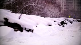 Cars covered with snow in a residential area of Moscow. February stock video footage