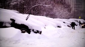 Cars covered with snow in a residential area of Moscow. February stock footage