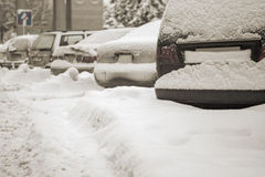 Cars covered with snow after snowfall in european city Royalty Free Stock Photo