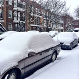 Cars covered by snow after the snowstorm Royalty Free Stock Photos