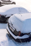 Cars covered with snow during winter blizzard Royalty Free Stock Photos