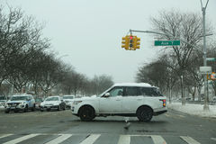 Cars crossing Ocean Parkway in Brooklyn, NY after massive Winter Storm Niko strikes Northeast Royalty Free Stock Image