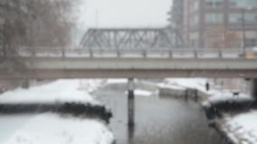 Cars crossing a river in a blizzard stock footage