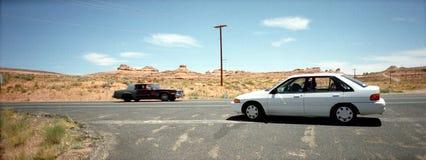 Cars on a crossroad Stock Photos