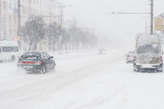 Cars at a crossroads. Snow storm in the city of Cheboksary, Chuvash Republic, Russia. 01/17/2016 Royalty Free Stock Image