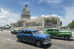 Cars in Cuba. A couple of old american cars passing in front of the Capitolio in Havana, Cuba Stock Photo