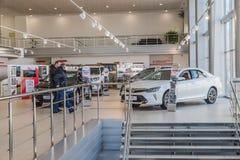Cars and customer in showroom of dealership Toyota in Nizhny Novgorodcity in 2018 stock photo