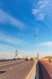 Cars and cyclist crossing the Waal bridge stock image