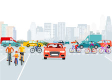 Cars and cyclists in city Stock Photos
