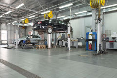 Cars in a dealer repair station in Moscow, Russia Stock Photos