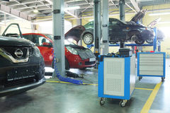 Cars in a dealer repair station Royalty Free Stock Photo