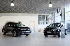 Cars in a dealer's showroom Royalty Free Stock Images