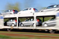 Cars delivered on a train Royalty Free Stock Photos